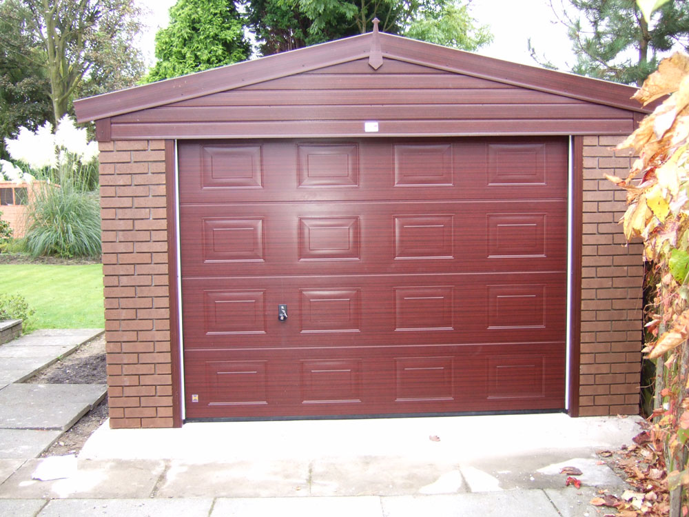 Woodthorpe wooden door garages concrete garages for Brick garage plans