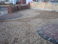 Gravel driveway  fencing & paved semi circles