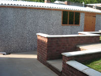 New garage with retaining walls & steps