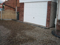 Royale garage with gravelled  driveway & bow top fencing